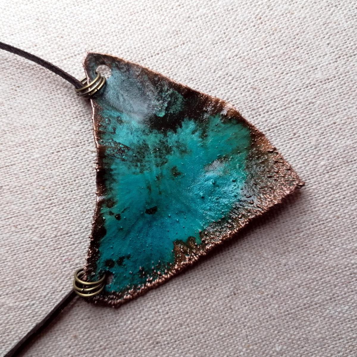 Ancient looking copper pendant